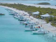 An image of boats in the sand at The Annual Bahamas Poker Run