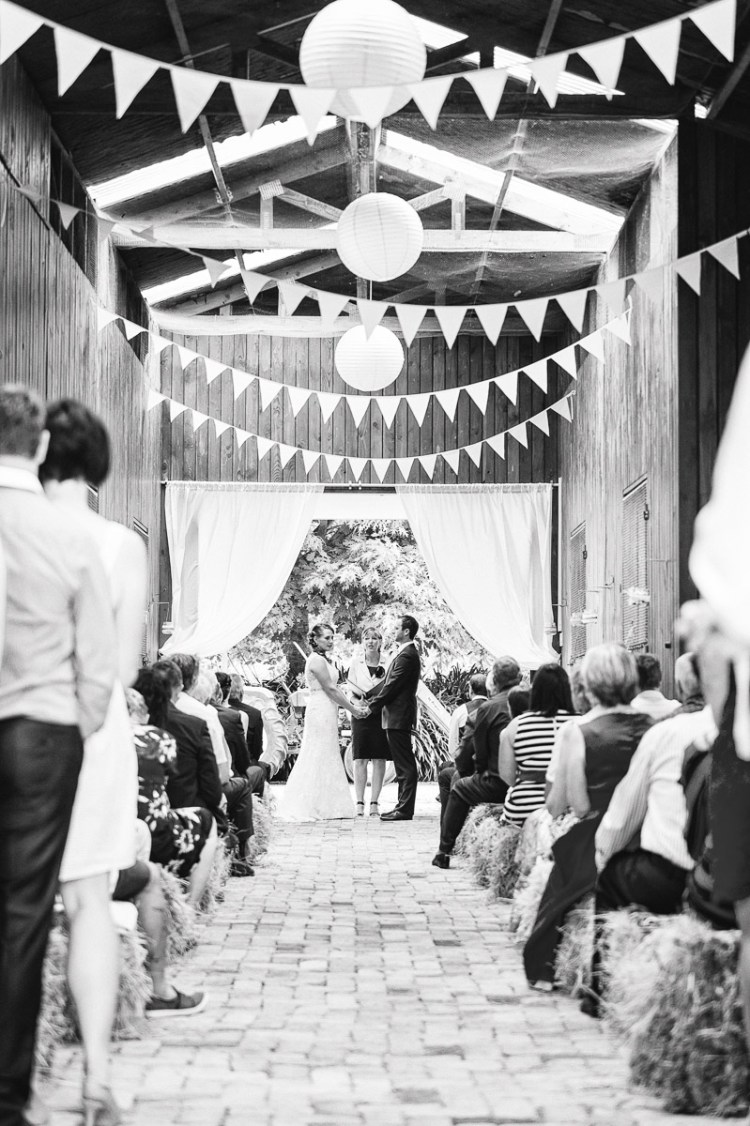 barn wedding with hay bales and bunting