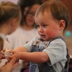 Toddler Giving something