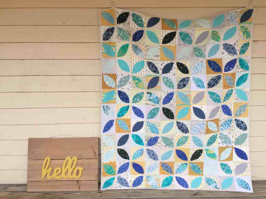 Yoga and the turquoise and gold orange peel quilt
