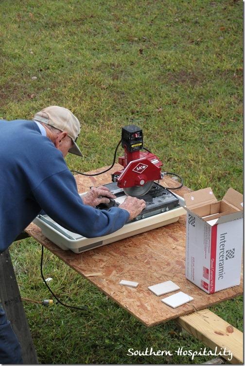 dad cutting tile