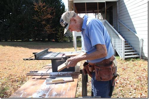 Dad cutting wood