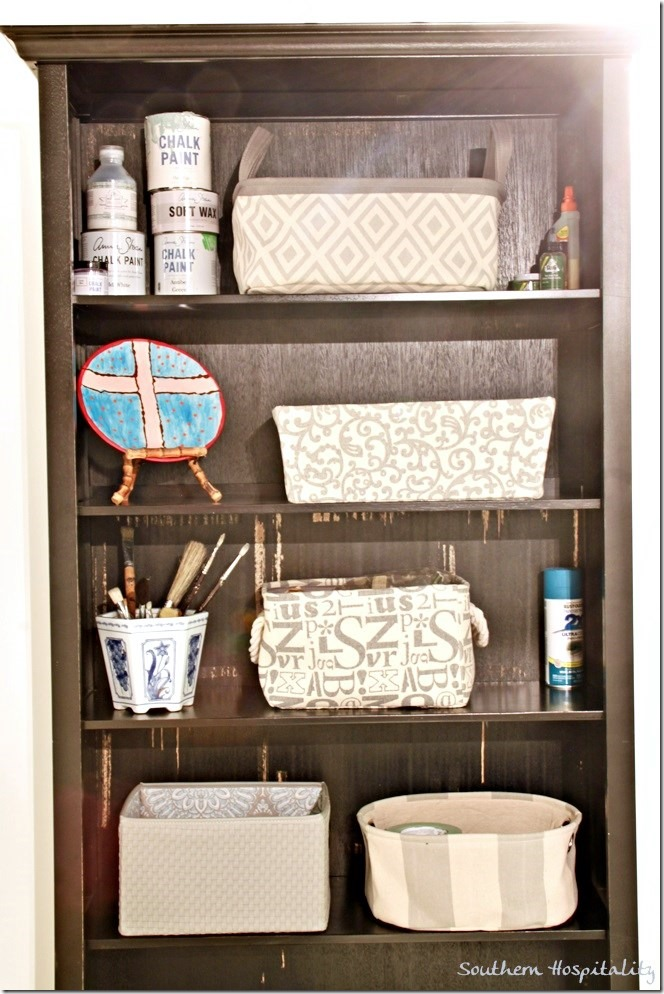 black bookcase with baskets