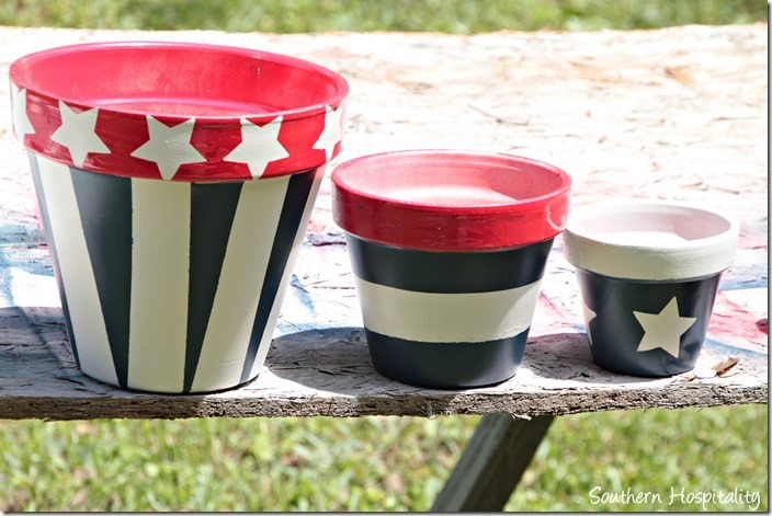 clay pots red white and blue
