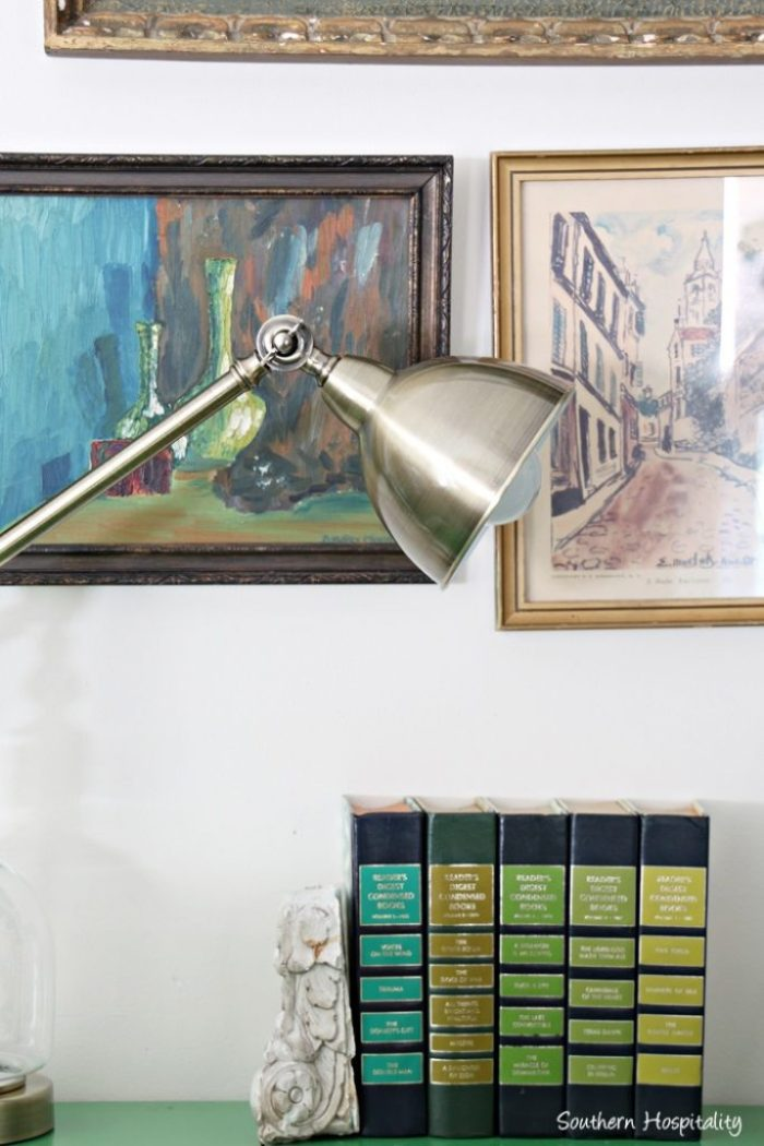 brass lamp on green table