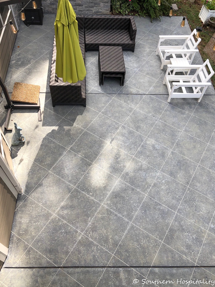 create a tile look on concrete patio using tape and stone finish paint