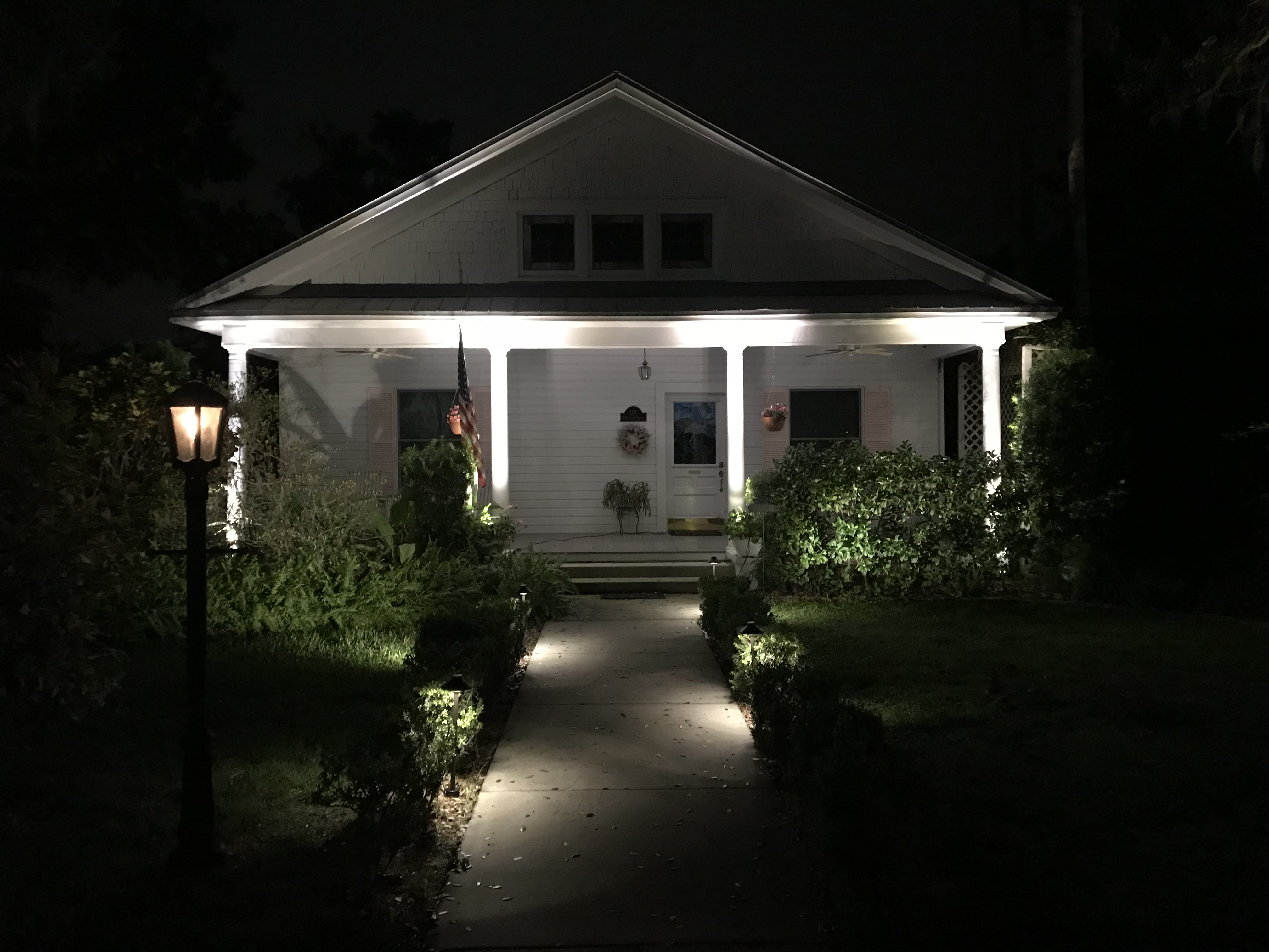 front of white house with indirect lighting