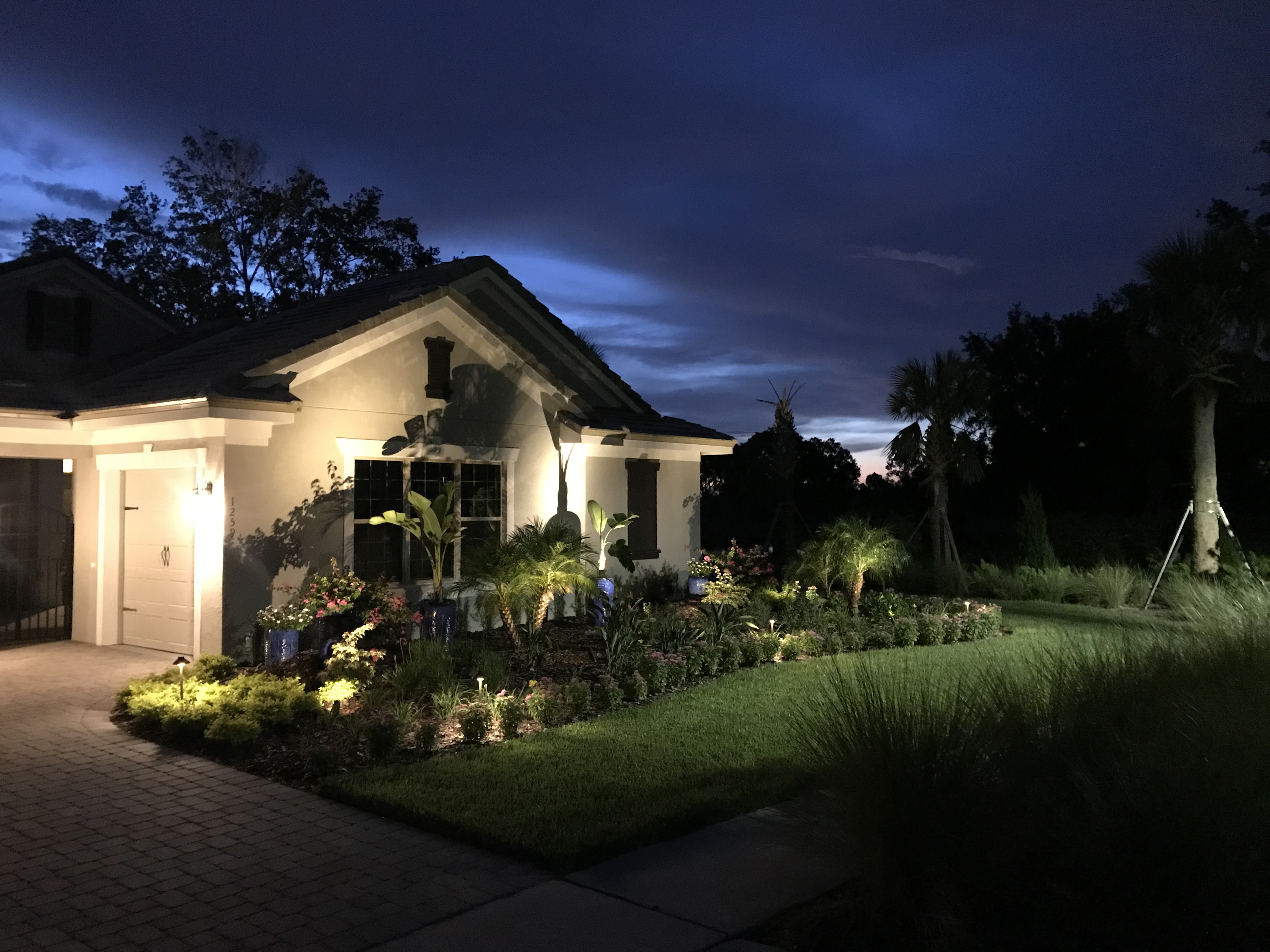 view of home with landscape lighting in front yard