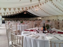 Bunting and starlights over the dancefloor gave this wedding marquee at West Hill Park in Hampshire the wow factor!