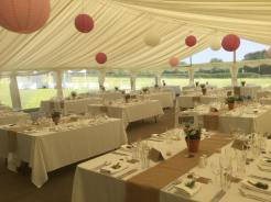 Large square tables were used to provide a picnic style wedding in our multispan marquee with panoramic windows and clear gable.