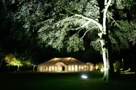 The Marquee shape is highlighted and the trees illuminated against the night sky ...