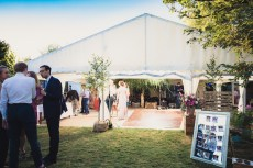 Guests spill outside as the transition between daytime and evening receptions ...