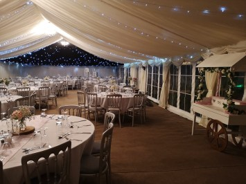Pealights in the roof complete the look in this wedding marquee.