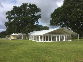 Mix and Match! A multispan marquee with traditional style reception tent and entrance awning with georgian windows rather than than the panoramic windows throughout.