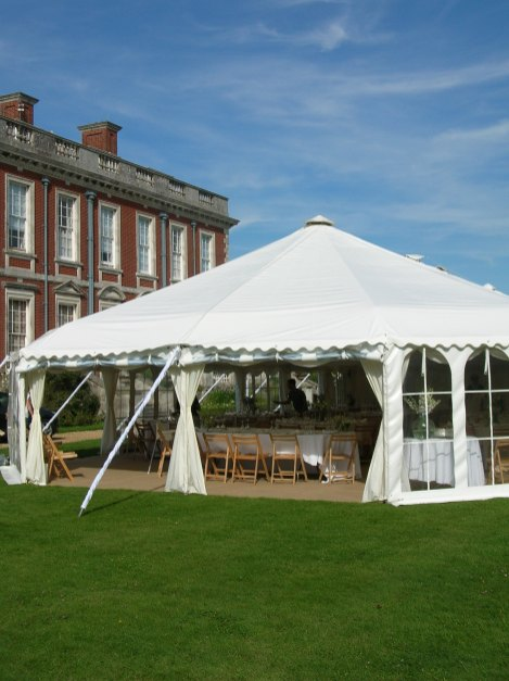 Traditional style marquee with windows rolled up ..