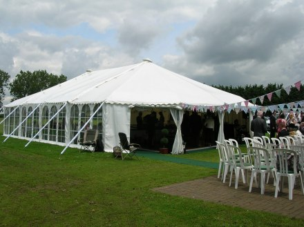 A traditional style marquee linked to a cricket pavillion.