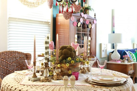 Table Centerpiece with vintage brass candesticks on crocheted tablecloth