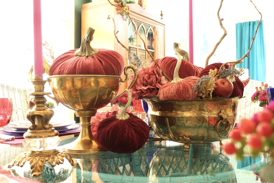Berry colored velvet pumpkins centerpiece in vintage brass containers