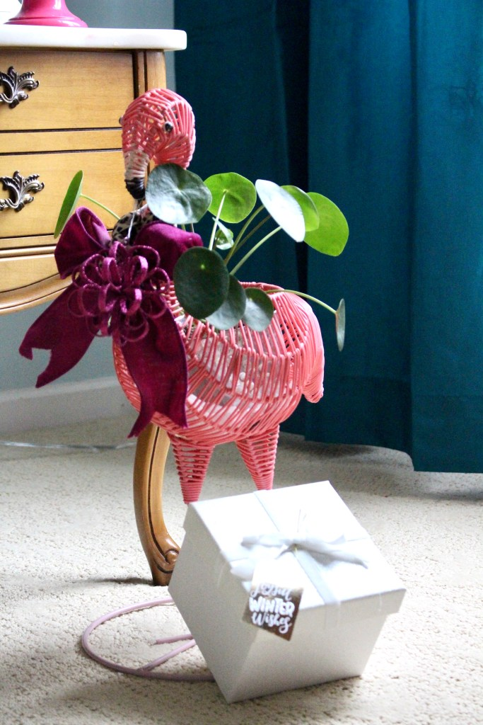 Large Pink Flamingo Plant Stand with Christmas bow and ornaments