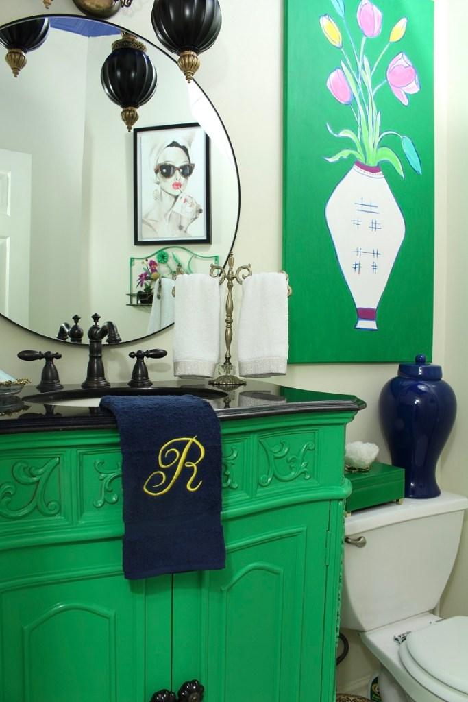 Green Vanity and Woman Art in Guest Bathroom