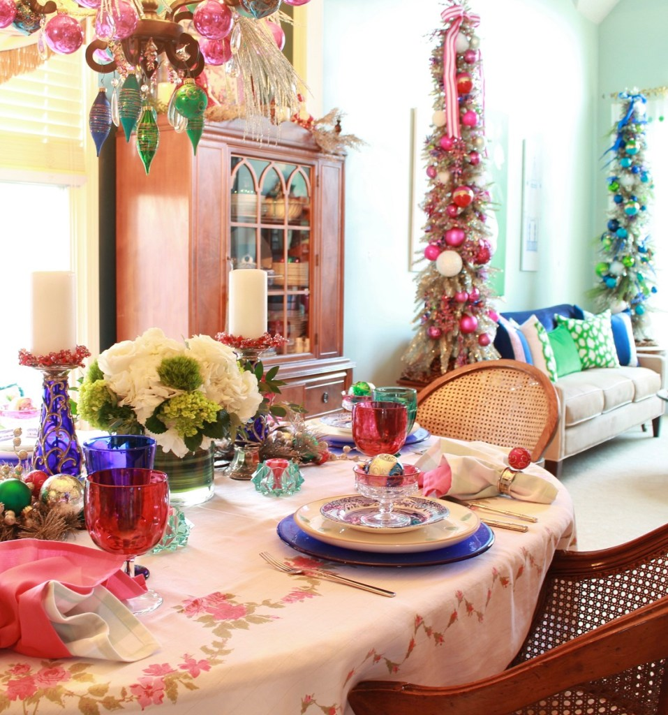 Colorful Vintage Christmas Tablescape with blue chargers and vintage pink tablecloth