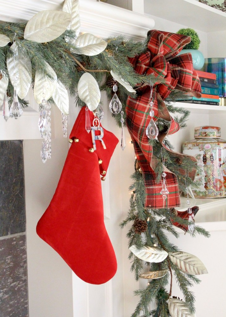 Red Christmas Stocking and bow on garland