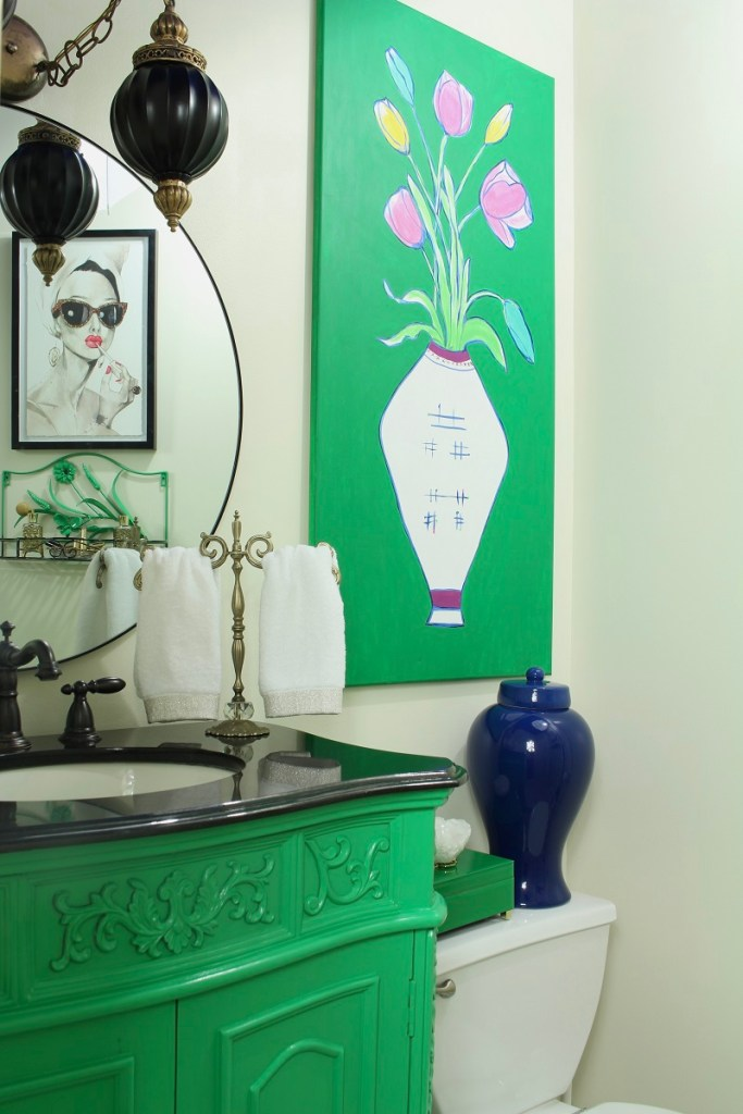 Small bathroom makeover with lacquered furniture and vintage southern vibes. Colorful powder room featuring a blue ginger jar.