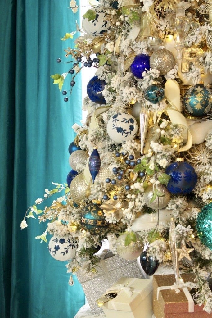 Flocked Christmas Tree with Elegant Blue and White Ornaments