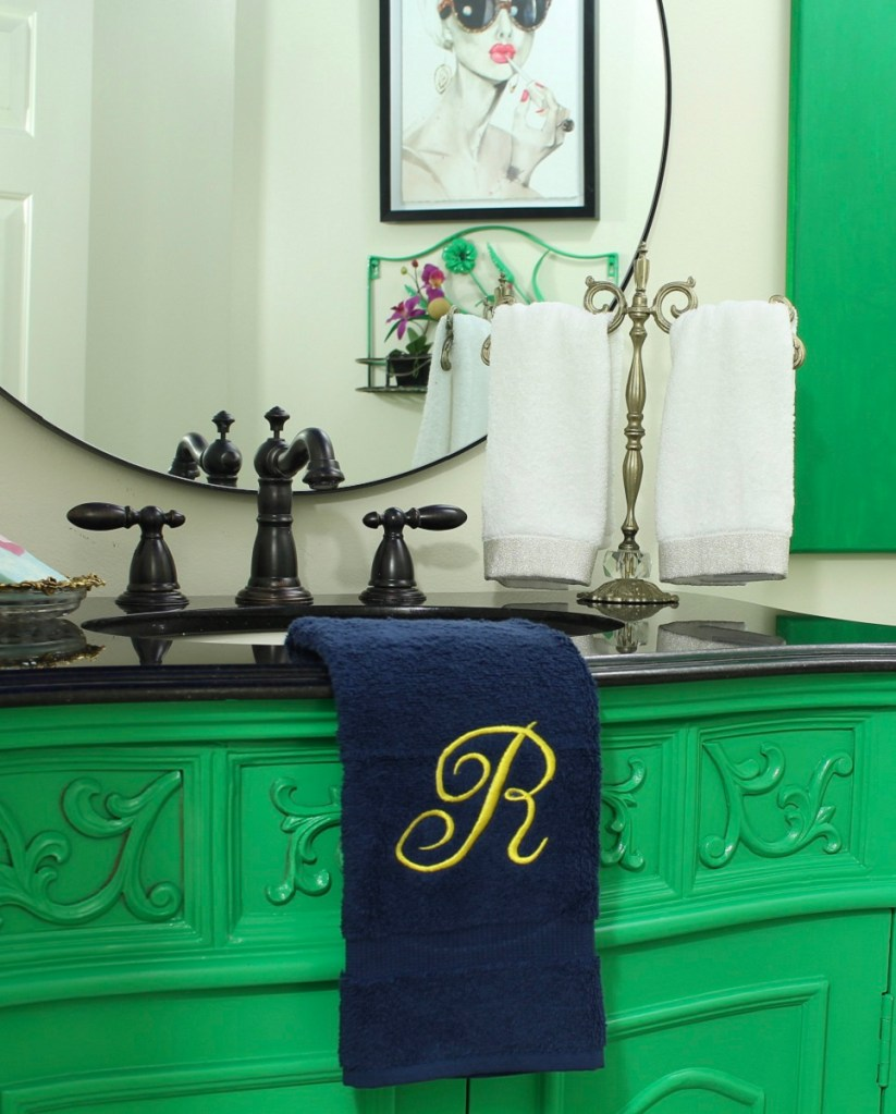 Small bathroom makeover with lacquered furniture and vintage southern vibes. Colorful room.