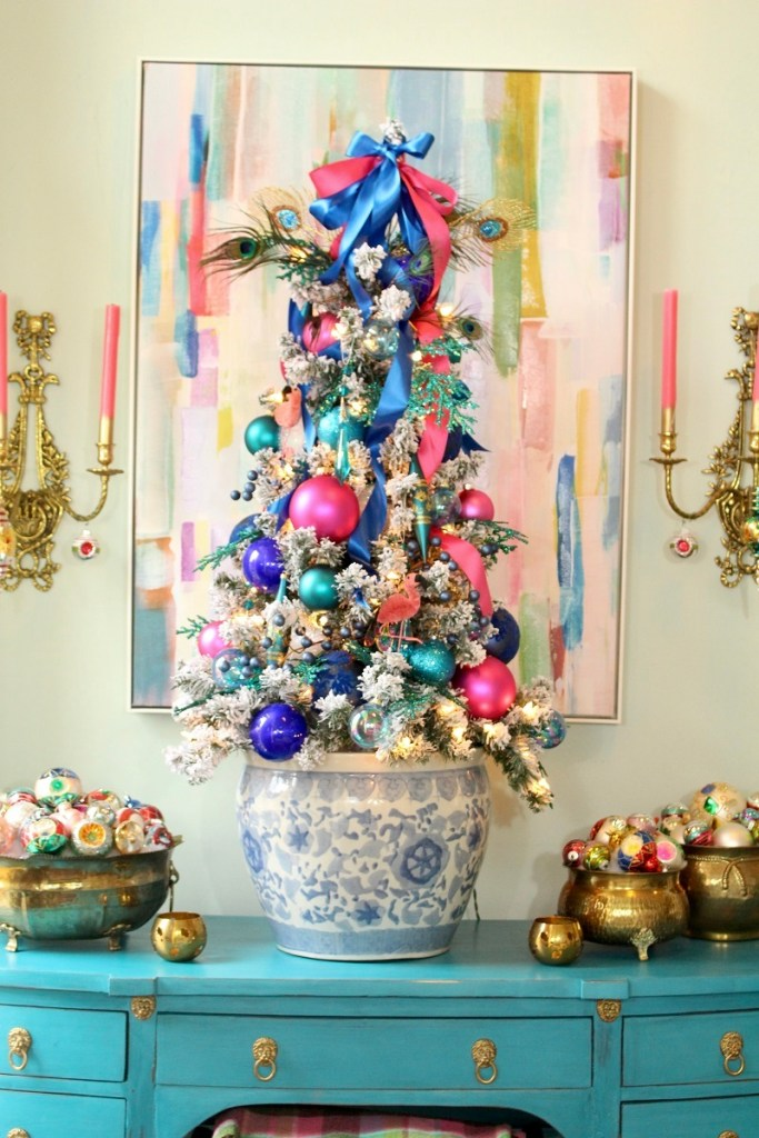 Flocked tree with Pink and Blue Ornaments on Turquoise Desk