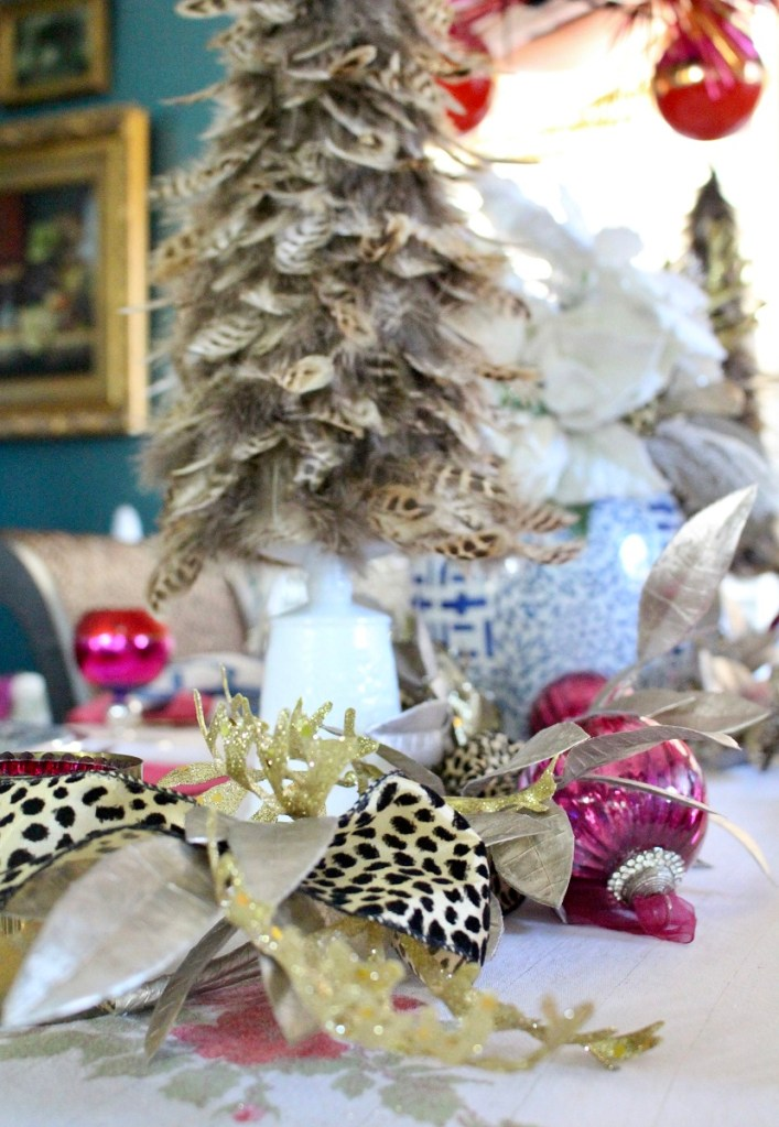 Cheetah Print Ribbon and Feather Tree on Christmas Table
