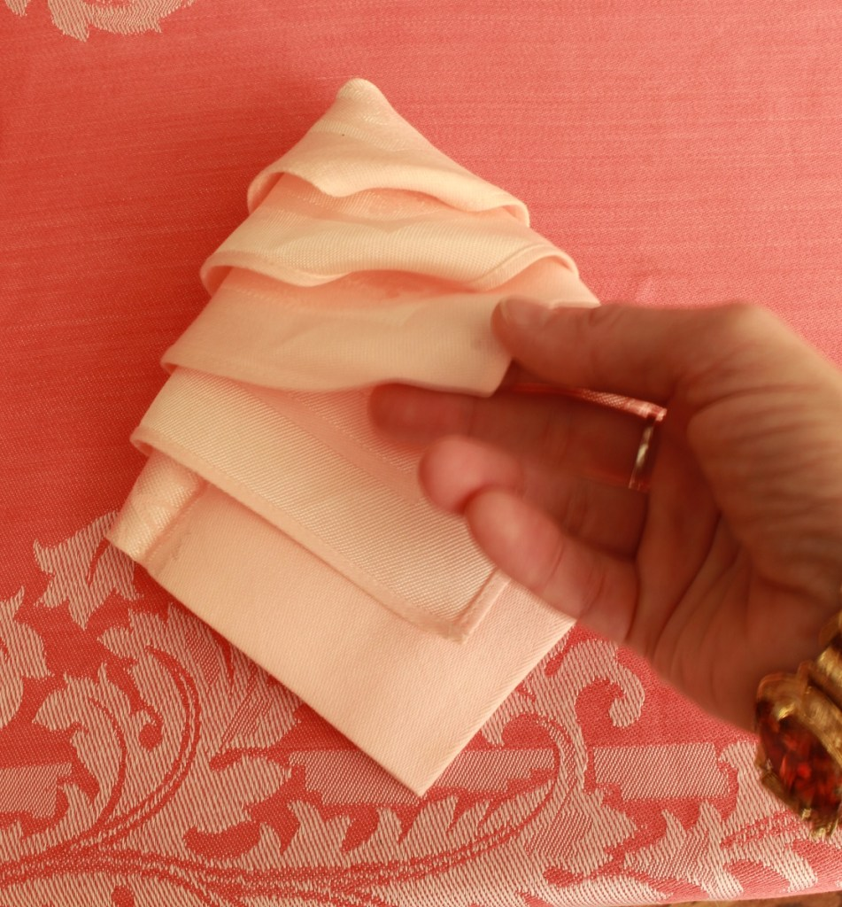Hand folding Pink Napkin as Christmas Tree