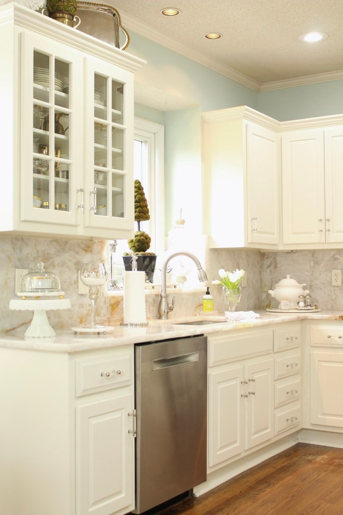 White Kitchen Cabinets with glass doors and stainless steal dishwasher