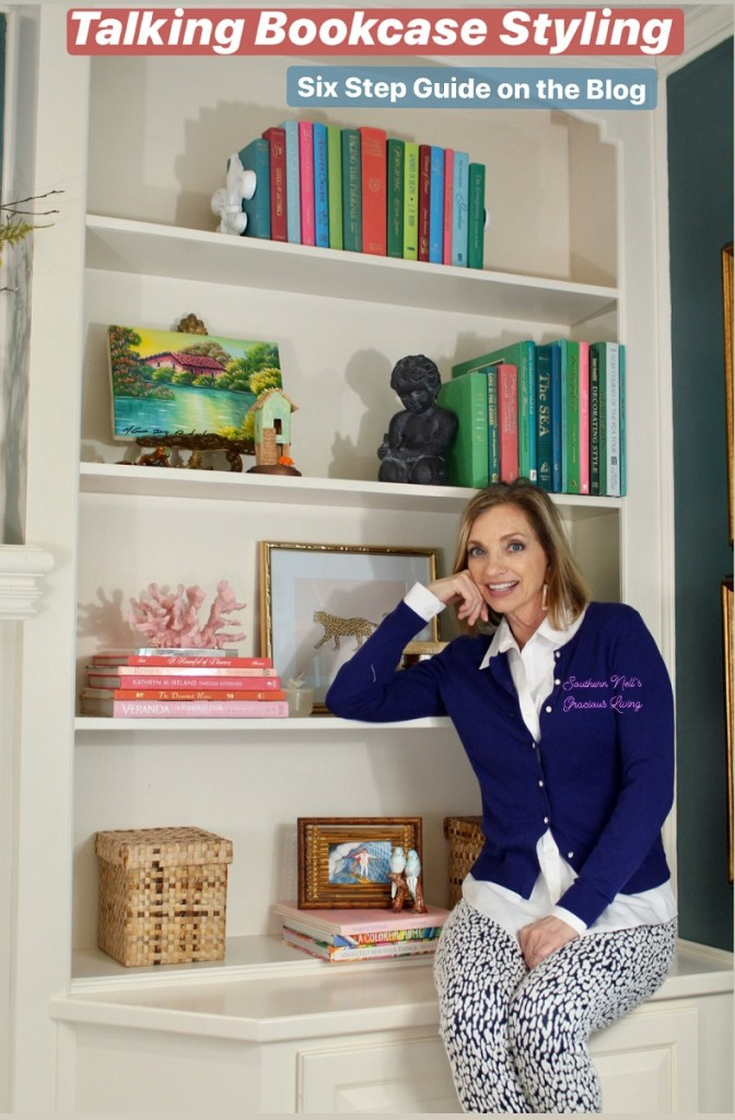 Woman in Blue Sweater sitting on bookcase
