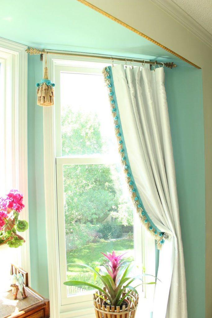 Bay Window with Elegant White Curtains and Pom Pom Fringe