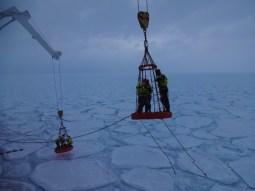 Researchers from South Africa and Abu Dabi deploying trackers on the pancakes to study waves in the ice