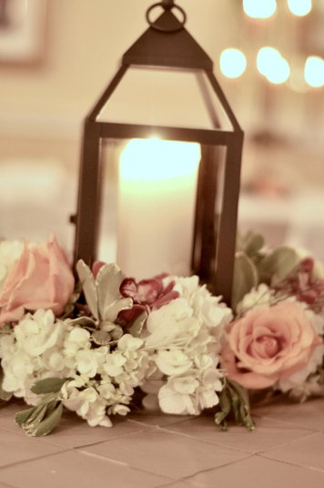 lanternwithflowerscenterpieces  Southern Productions