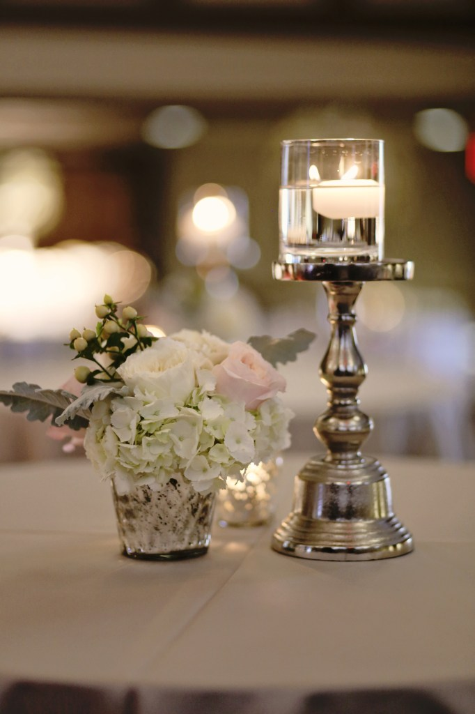 ivory and blush centerpiece in mercury glass