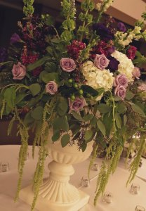purple urn arrangement by meridian ms florist