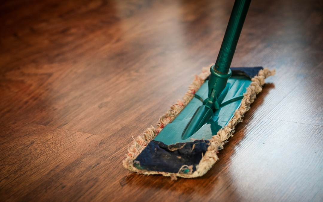Green mop on timber floor
