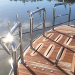 Stainless boat duckboard rail with rod holders