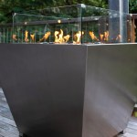 Square stainless gas fire pit with black pebbles made in Australia