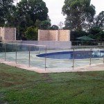 Stainless steel pool fencing with tinted glass panels