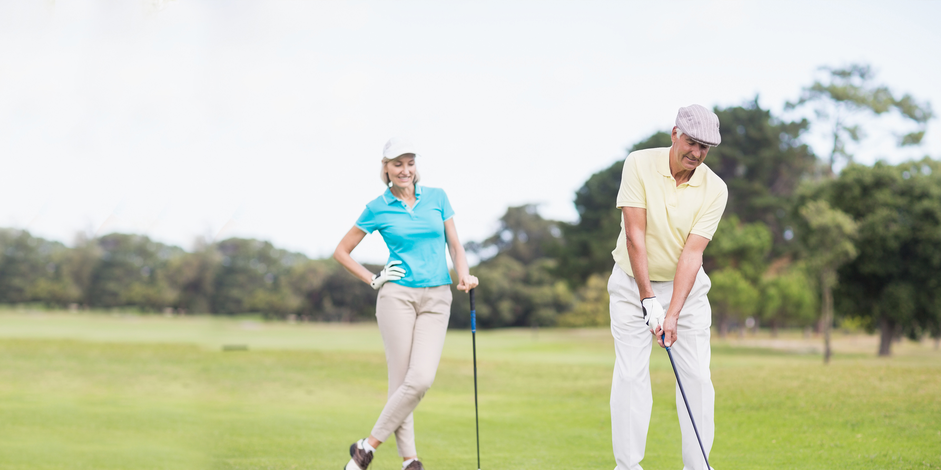 Older man golfing with his wife