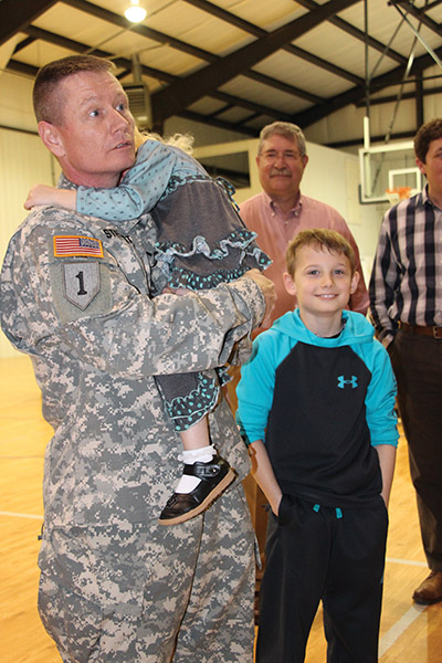Surprise homecoming, a local hero returns to his family