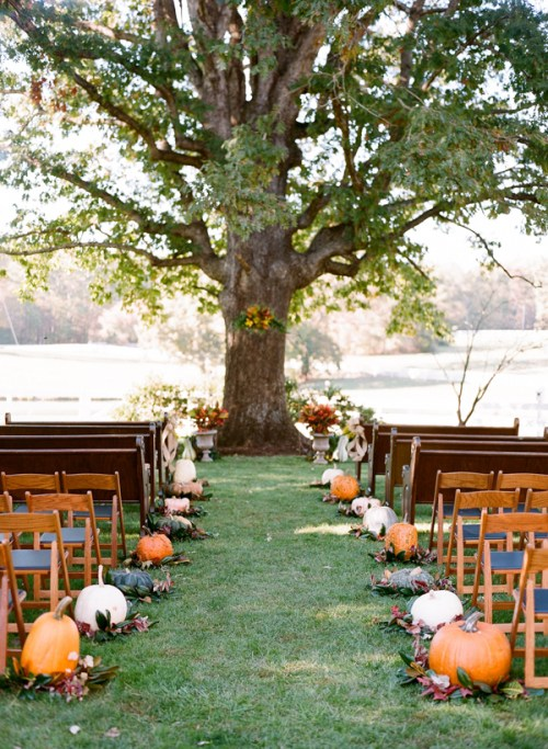 Pumpkin Themed Wedding with Outside Pumpkin Aisle and Oak Tree Background