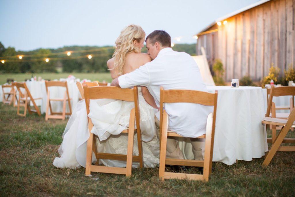 outdoor southern wedding, bride & groom, kissing her shoulder, southern yankee