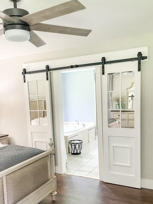 Easy DIY Sliding Barn Door With Mirrored Glass