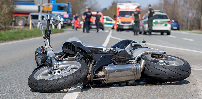 Motorcycle laying on road
