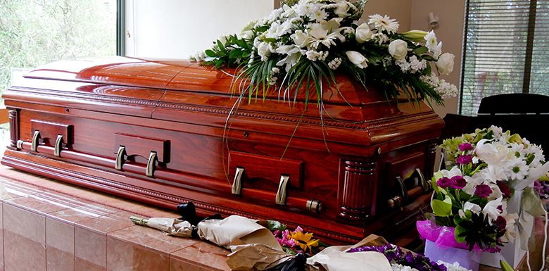 Casket and flowers at funeral